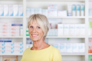Senior Female Pharmacist Smiling In Pharmacy