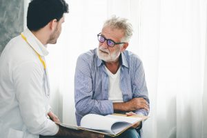 Professional psychologist doctor discussing with patient in therapy sessions at hospital room. Online Pharmacies Canada